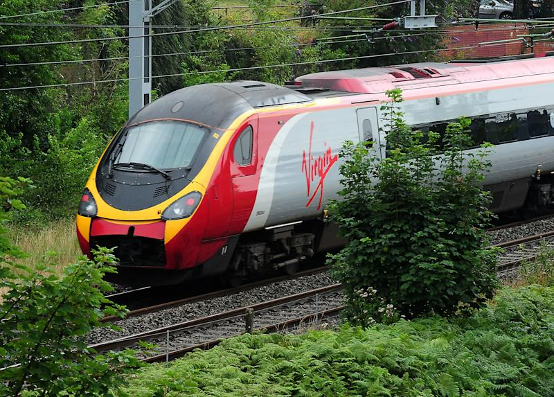 File photo dated 15/08/12 of a Virgin train. Virgin Trains has recorded the highest passenger satisfaction rating of any franchised train operator in Britain, just months before it is set to lose control of the West Coast route.
