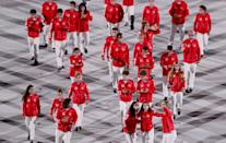 <p>TOKYO, JAPAN - JULY 23: Members of Team Canada lead their team out during the Opening Ceremony of the Tokyo 2020 Olympic Games at Olympic Stadium on July 23, 2021 in Tokyo, Japan. (Photo by Clive Brunskill/Getty Images)</p>