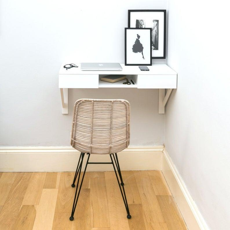 """<h3>Urbansize Floating Beech Desk</h3><br>This floating desk is handcrafted from beech wood with an efficient frame for tucking into an otherwise unused corner of your small space — plus, it also comes with two pullout drawers and an open interior shelf for extra storage.<br><br><strong>Urbansize</strong> Floating Beech Desk, $, available at <a href=""""https://go.skimresources.com/?id=30283X879131&url=https%3A%2F%2Fwww.etsy.com%2Flisting%2F225545435%2Ffloating-beech-desk"""" rel=""""nofollow noopener"""" target=""""_blank"""" data-ylk=""""slk:Etsy"""" class=""""link rapid-noclick-resp"""">Etsy</a>"""