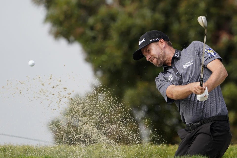Webb Simpson plays a shot from a bunker on the first hole during the first round of the U.S. Open Golf Championship, Thursday, June 17, 2021, at Torrey Pines Golf Course in San Diego. (AP Photo/Jae C. Hong)