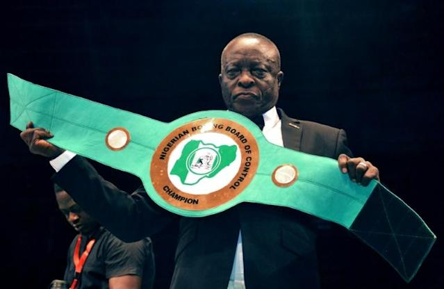 Boxing promoter Raufu Ladipo displays a lightweight belt to be contested by boxers during a GOtv title fight at the National Stadium in Lagos on April 15, 2018