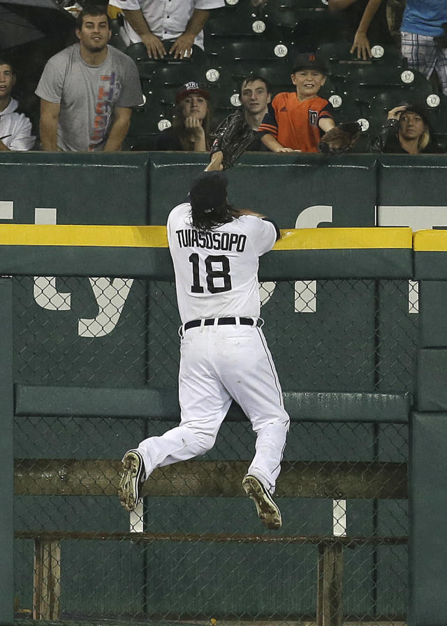 Detroit Tigers left fielder Matt Tuiasosopo tries to catch a Oakland Athletics' Brandon Moss two-run home run in the fifth inning of a baseball game in Detroit, Tuesday, Aug. 27, 2013. (AP Photo/Paul Sancya)