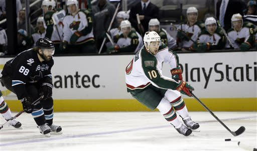Minnesota Wild right wing Devin Setoguchi (10) skates past San Jose Sharks defenseman Brent Burns (88) during the second period of an NHL hockey game in San Jose, Calif., Thursday, April 18, 2013. (AP Photo/Marcio Jose Sanchez)