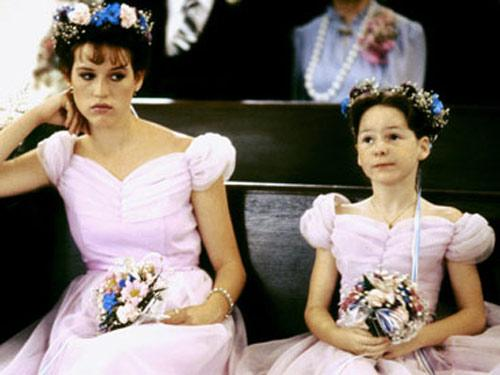 """<div class=""""caption-credit""""> Photo by: .</div><div class=""""caption-title""""></div>Poor Molly Ringwald! The <i>Sixteen Candles</i> star must be moping about her puffy sleeved get-up and the big wreath of flowers in hair."""