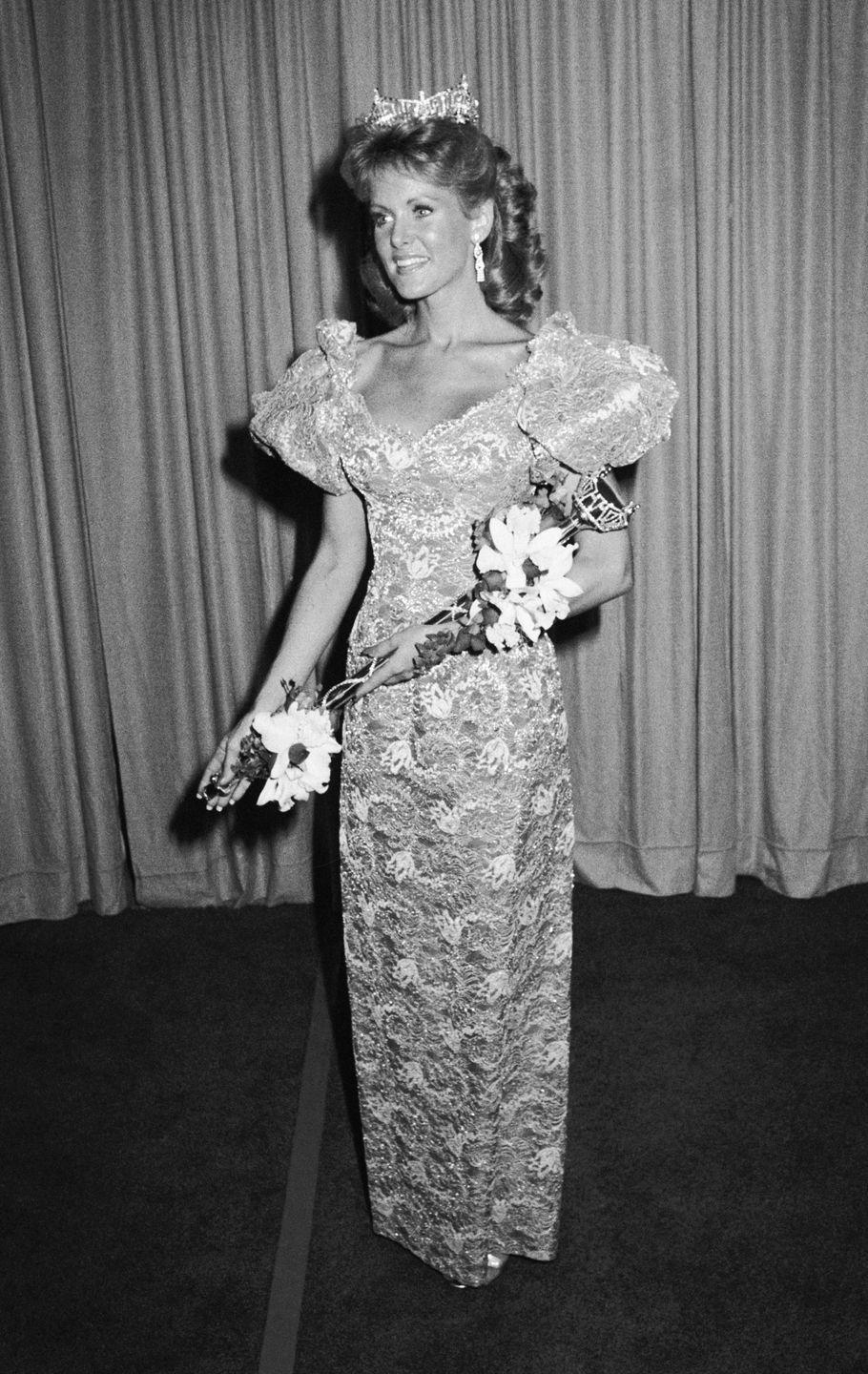 <p>Debra Maffett, 1983 Miss America, stood out in this lacy number. The puff sleeves added just the right amount of drama to the look.</p>