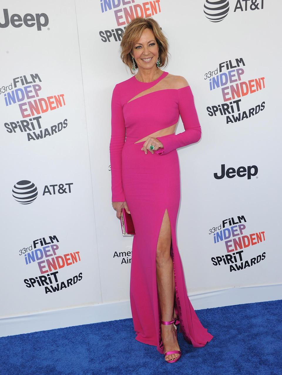 <p>The ageless<em> I, Tonya</em> actor flashed her shoulder, abs, and leg in a fitted fuchsia dress. (Photo: Getty Images) </p>