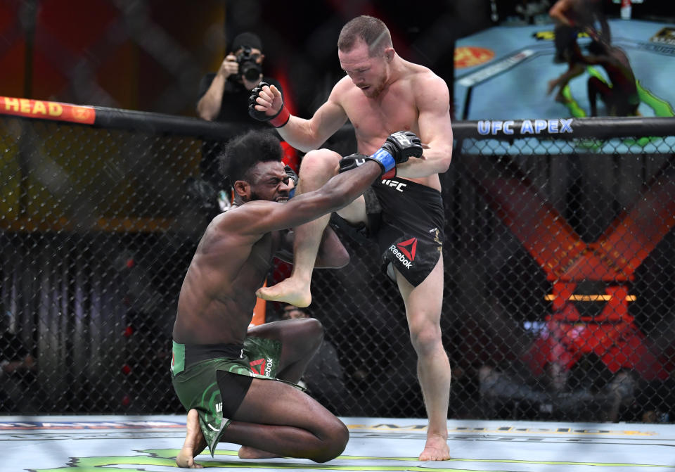 LAS VEGAS, NEVADA - MARCH 06: (R-L) Petr Yan of Russia delivers an illegal knee against Aljamain Sterling in their UFC bantamweight championship fight during the UFC 259 event at UFC APEX on March 06, 2021 in Las Vegas, Nevada. (Photo by Chris Unger/Zuffa LLC)