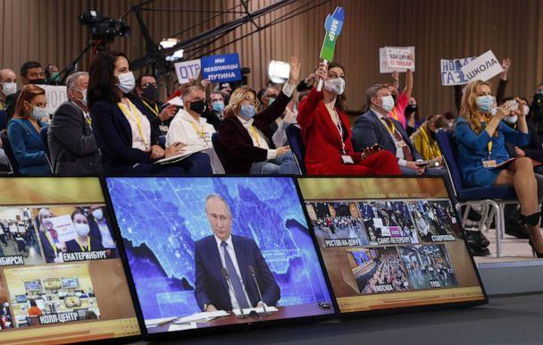 PHOTO: Journalists look at a screen showing Russian President Vladimir Putin during his annual press conference via a video link from the Novo-Ogaryovo state residence, at the World Trade Center in Moscow, Dec. 17, 2020. (Maxim Shipenkov/EPA via Shutterstock)