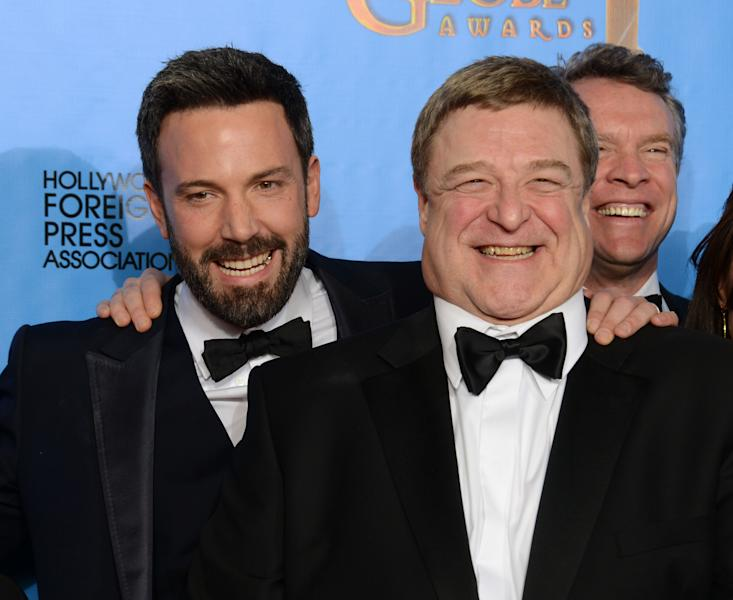 """Actor and director Ben Affleck, left, and actor John Goodman pose with the award for best motion picture - drama for """"Argo"""" backstage at the 70th Annual Golden Globe Awards at the Beverly Hilton Hotel on Sunday Jan. 13, 2013, in Beverly Hills, Calif. (Photo by Jordan Strauss/Invision/AP)"""