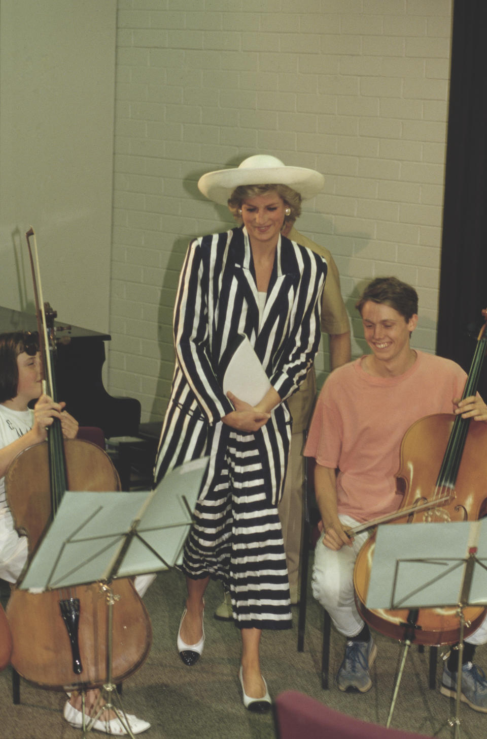 Diana, Princess of Wales  (1961 - 1997) visits the Music College of the Victorian College of the Arts in Melbourne, Australia, January 1988. She is wearing a black and white striped dress by Roland Klein.  (Photo by Jayne Fincher/Princess Diana Archive/Getty Images)
