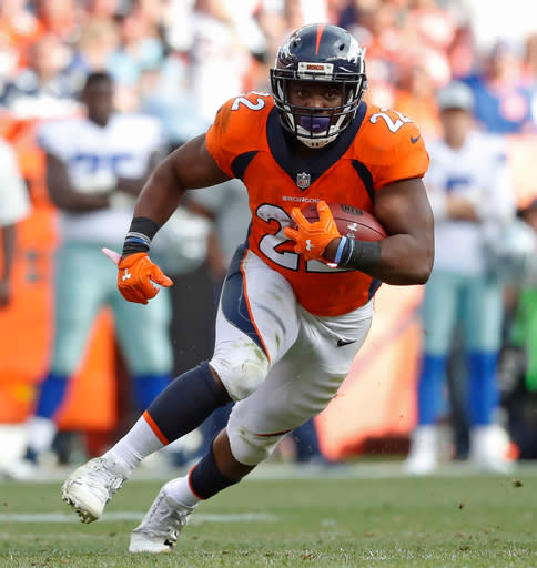 FILE - In this Sept. 17, 2017, file photo, Denver Broncos running back C.J. Anderson runs against the Dallas Cowboys during the second half of an NFL football game, in Denver. A person familiar with the situation tells The Associated Press that running back C.J. Anderson has been released by the Broncos. The person spoke on condition of anonymity because the team hasn't officially announced Anderson's departure, which was first reported by the NFL Network. (AP Photo/Jack Dempsey, File)