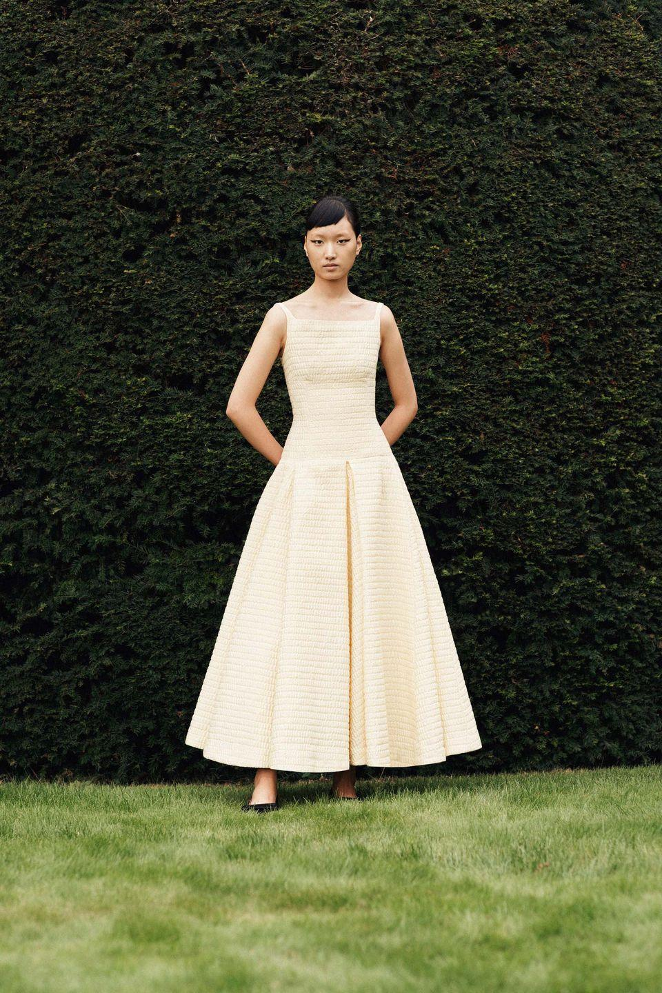 """<p>For the new summer season, Emilia Wickstead was inspired by the 1961 movie Last Year at Marienbad, which tells the story of an unnamed sophisticate who attempts to persuade a similarly unnamed woman that they have not only previously met, but that they were also romantically involved and had planned to elope together. The woman recalls no such encounter and so begins a<br>sensual and philosophical examination of the uncertainty of truth.</p><p>""""Strikingly composed and beautifully shot in CinemaScope, Last Year at Marienbad hypnotically merges chronology to blur the boundaries of reality and fantasy, the past and the present,"""" the brand explains. """"These themes and juxtapositions are woven into the spring/summer 2022 collection. A melding of old-world and modern proportions is at play.""""</p>"""