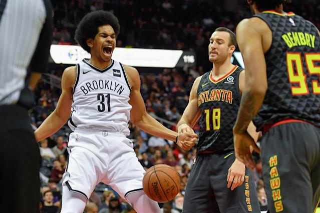 Dec 4, 2017; Atlanta, GA, USA; Brooklyn Nets center Jarrett Allen (31) reacts after a dunk behind Atlanta Hawks center Miles Plumlee (18) during the second half at Philips Arena. Mandatory Credit: Dale Zanine-USA TODAY Sports TPX IMAGES OF THE DAY