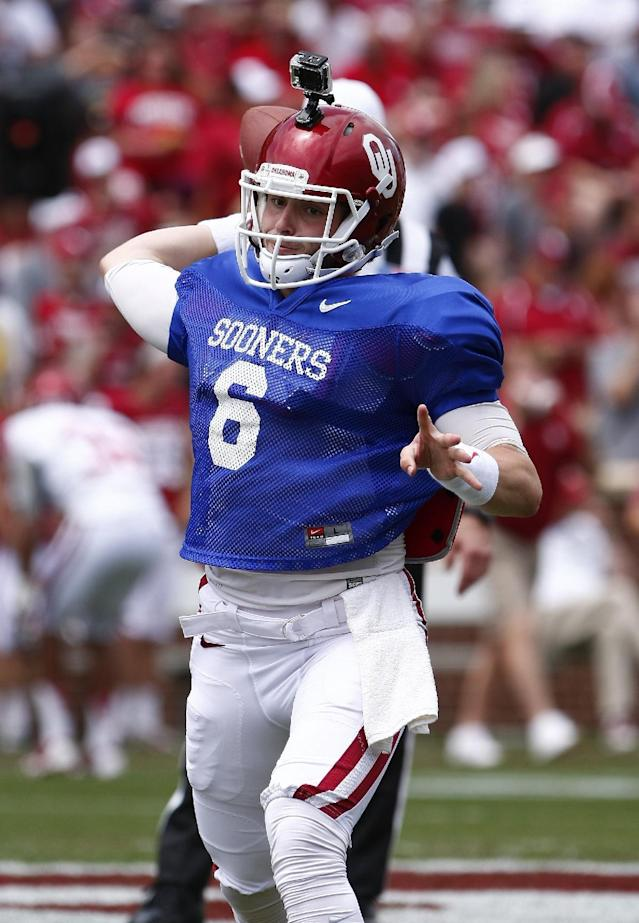 Oklahoma quarterback Baker Mayfield (6) throws a pass during their annual spring NCAA college football game in Norman, Okla., Saturday, April 12, 2014. (AP Photo/Alonzo Adams)