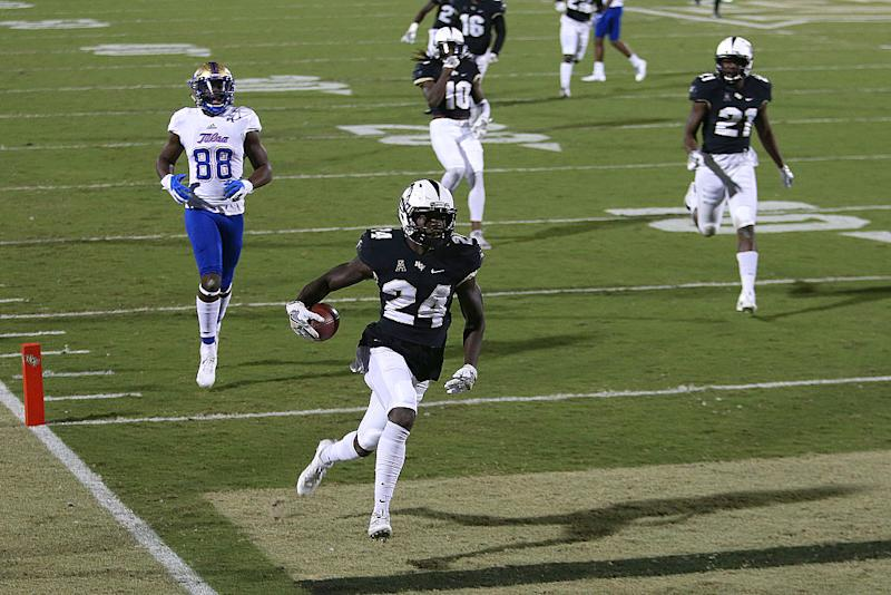 D.J. Killings returns an interception for a touchdown vs. Tulsa last November. (Getty Images)