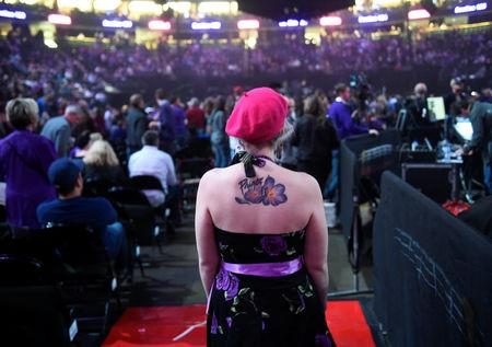 Kelly Kossett of Minnetonka MN looks for a seat before the tribute to late musician Prince, at the Xcel Energy Center in St. Paul, Minnesota, U.S. October 13, 2016.  REUTERS/Craig Lassig