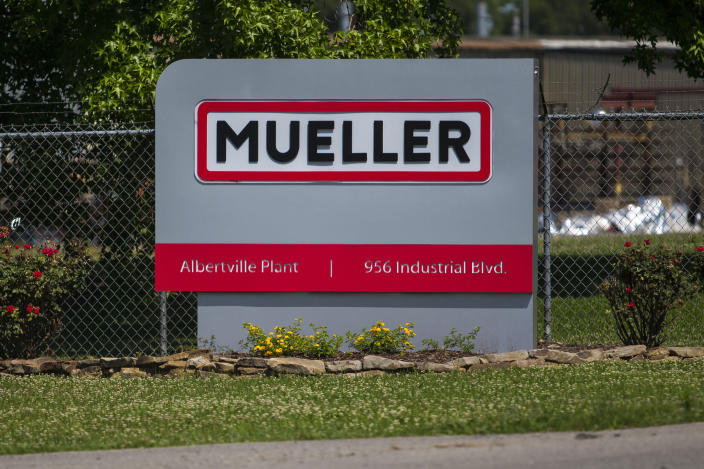 A sign for Mueller Co. is displayed at the entrance to the fire hydrant plant where police said multiple people were shot to death and others were wounded in Albertville, Ala., on Tuesday, June 15, 2021. (AP Photo/Vasha Hunt)