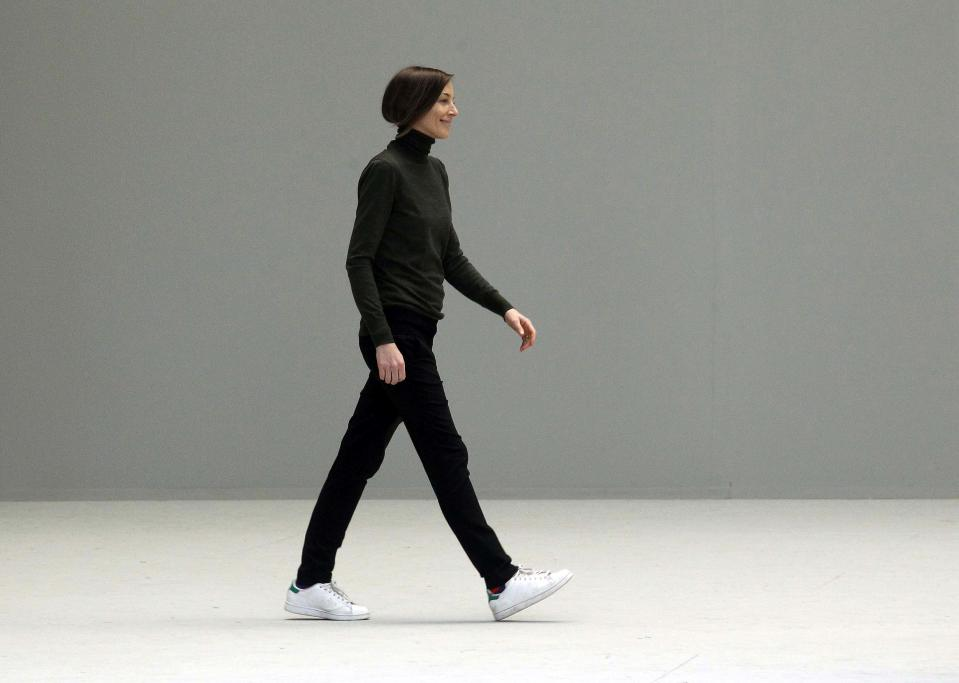 Phoebe Philo walks the runway in Stan Smiths during the Celine Ready to Wear Autumn/Winter 2011/2012 show during Paris Fashion Week on March 6, 2011, in Paris. (Photo: Michel Dufour/WireImage)