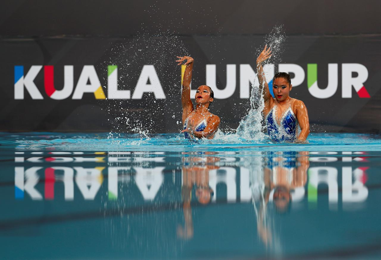 Southeast Asian (SEA) Games - Synchronised Swimming - Duet Technical Routine - August 18, 2017 - Allyssa Marey Salvador and Ruth Desiree Abiera of the Philippines perform their routine.  REUTERS/Edgar Su