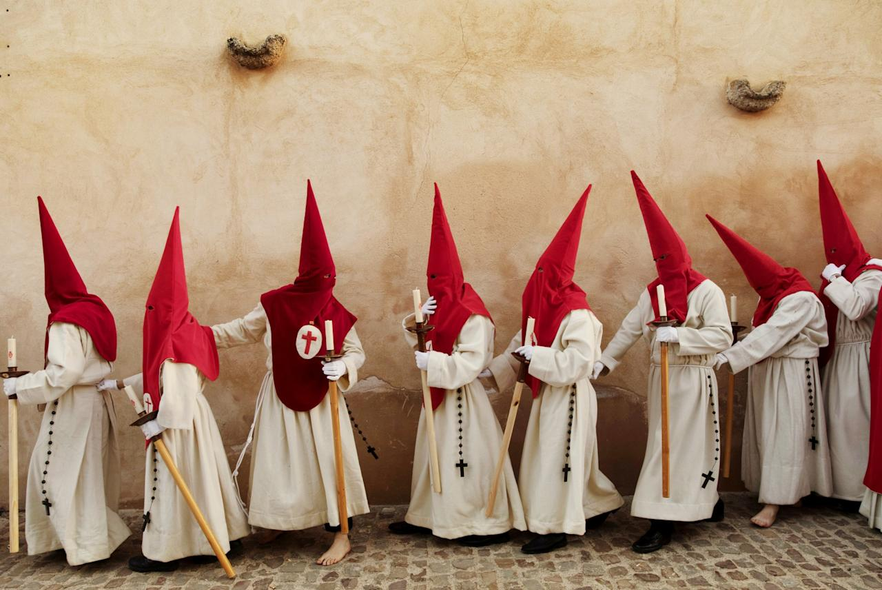 <p>Penitents from 'Real Cofradia del Santisimo Cristo de las Injurias' brotherhood take part in a procession in Zamora, Spain. (Rex features) </p>