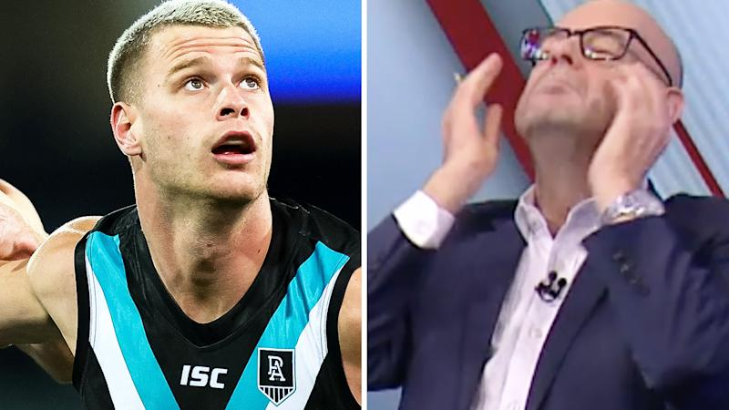 Peter Ladhams is pictured on the left and AFL journalist Mark Robinson is pictured on the right.