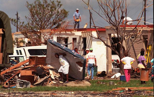 <p>A Mormon church group helps Florida City, Fla. residents clear debris and build roofs in this Aug. 29 1992 file photo, as cleanup continued after Hurricane Andrew moved through the area. (AP Photo/ Lynne Sladky, File) </p>