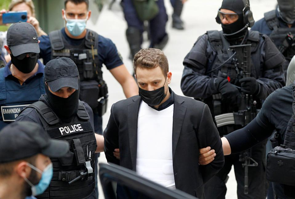Pilot Babis Anagnostopoulos, husband of murdered Caroline Crouch, leaves the court in Athens (EPA)