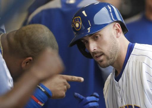 Milwaukee Brewers' Travis Shaw celebrates after hitting a home run during the second inning of a baseball game against the New York Mets Friday, May 25, 2018, in Milwaukee. (AP Photo/Morry Gash)