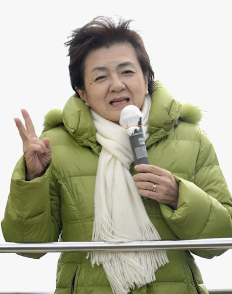 """In this Dec. 12, 2012 photo, Yukiko Kada, the leader of the Tomorrow Pary, speaks during her parliamentary elections campaign in Osaka, western Japan. The buzz over Japan's parliamentary elections this Sunday, Dec. 16, has been all about """"the third force"""" - a clear sign of the prevailing disenchantment over both the party that ruled for decades after World War II and the rival party that took over in 2009. The Tomorrow Party, formed just two weeks ago, wants to phase out nuclear power within 10 years. Leader Kada, the governor of Shiga prefecture and an environmental expert, has a clean image. But that was tainted when she linked with Ichiro Ozawa, a veteran politician with a reputation as a power broker who bolted from the ruling DPJ earlier this year. (AP Photo/Kyodo News) JAPAN OUT, MANDATORY CREDIT, NO LICENSING IN CHINA, FRANCE, HONG KONG, JAPAN AND SOUTH KOREA"""