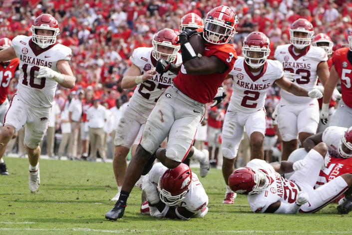 Georgia running back Zamir White (3) breaks through the Arkansas line as he runs for a touchdown during the second half of an NCAA college football game Saturday, Oct. 2, 2021, in Athens, Ga. (AP Photo/John Bazemore)