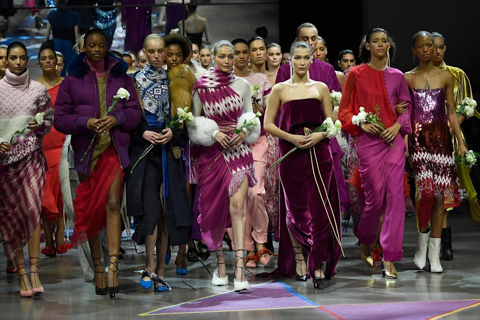 <p>The supermodel sisters were joined by Ashley Graham (second from the left, to the back) at the designer's show. <em>[Photo: Getty]</em> </p>