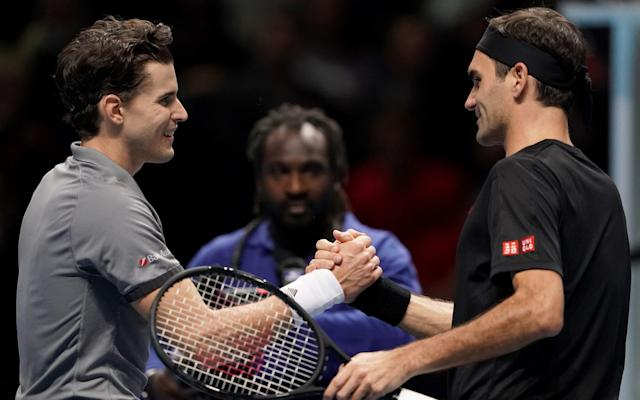 Roger Federer (right) lost 7-5, 7-5 to Dominic Thiem on London on Sunday night - PA Wire