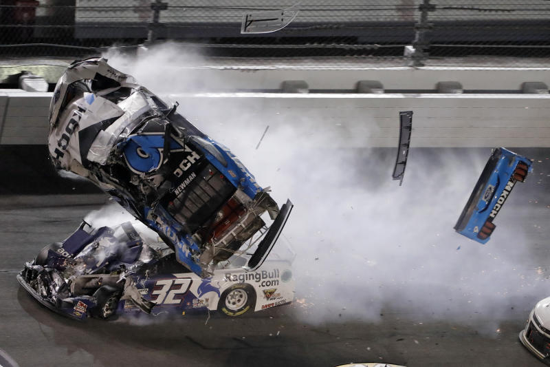 FILE - In this Feb. 17, 2020, file photo, Ryan Newman (6) goes airborne after crashing into Corey LaJoie (32) during the NASCAR Daytona 500 auto race at Daytona International Speedway in Daytona Beach, Fla. Newman says he will be ready to race when NASCAR resumes competition. He suffered a heady injury in the season-opening race at Daytona International Speedway. NASCAR says he still must be medically cleared. (AP Photo/Chris O'Meara, File)