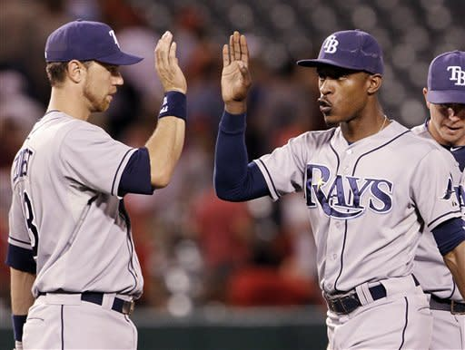 Tampa Bay Rays Ben Zobrist, left, and B.J. Upton celebrate their 7-0 shutout of the Los Angeles Angels in a baseball game in Anaheim, Calif., Thursday, Aug. 16, 2012. (AP Photo/Reed Saxon)