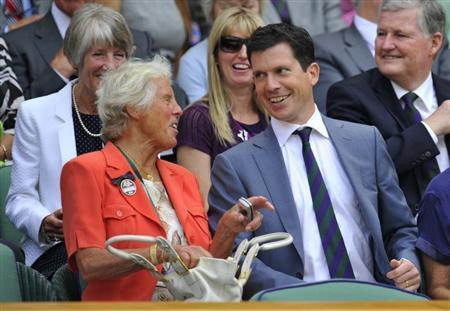 Former British tennis players Anne Jones (L) and Tim Henman talk on Centre Court at the 2010 Wimbledon tennis championships in London, June 24, 2010. REUTERS/Toby Melville