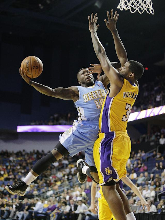 Denver Nuggets' Nate Robinson, left, puts up a shot against Los Angeles Lakers' Shawne Williams in the second half of an NBA preseason basketball game on Tuesday, Oct. 8, 2013, in Ontario, Calif. The Lakers won 90-88. (AP Photo/Jae C. Hong)