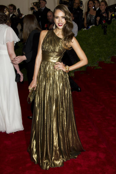 Jessica Alba arrives at the Metropolitan Museum of Art Costume Institute gala benefit, celebrating Elsa Schiaparelli and Miuccia Prada, Monday, May 7, 2012 in New York. (AP Photo/Charles Sykes)