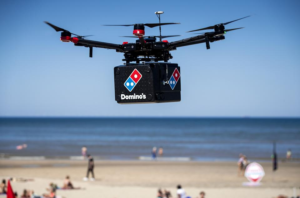 A drone of pizza chain Domino's transports a box during a testing session on the beach of Zandvoort, The Netherlands, on June 25, 2020. (Photo by Sem VAN DER WAL / ANP / AFP) / Netherlands OUT (Photo by SEM VAN DER WAL/ANP/AFP via Getty Images)