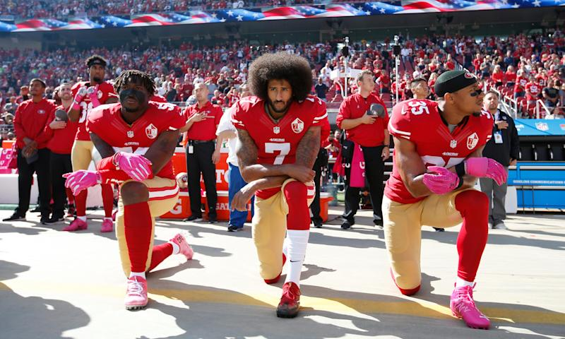 49ers outside linebacker Eli Harold, left, quarterback Colin Kaepernick, center, and safety Eric Reid kneel during the anthem in 2016. (AP)
