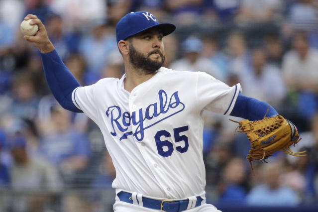 Kansas City Royals starting pitcher Jakob Junis throws during the first inning of a baseball game against the Detroit Tigers Tuesday, June 11, 2019, in Kansas City, Mo. (AP Photo/Charlie Riedel)