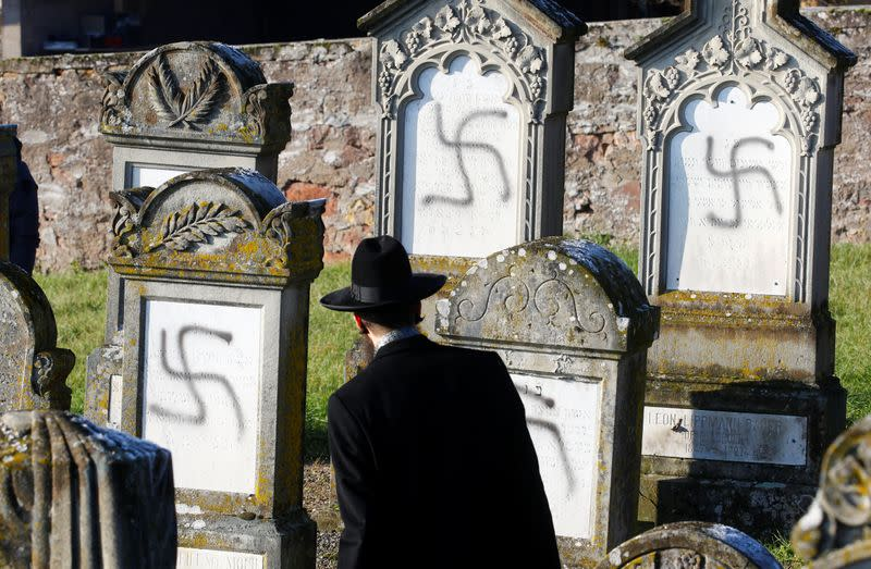 Chief Rabbi Weill looks at graves desecrated with swastikas on the Jewish cemetery in Westhoffen