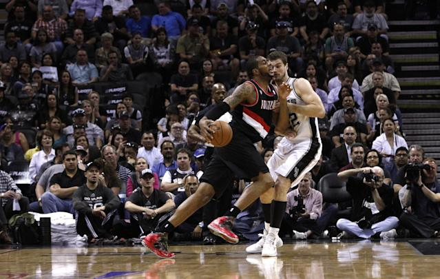 SAN ANTONIO, TX - MAY 6: LaMarcus Aldridge #12 of the Portland Trail Blazers drives around Tiago Splitter #22 of the San Antonio Spurs in Game One of the Western Conference Semifinals during the 2014 NBA Playoffs at the AT&T Center on May 6, 2014 in San Antonio, Texas. NOTE TO USER: User expressly acknowledges and agrees that, by downloading and/or using this photograph, user is consenting to the terms and conditions of the Getty Images License Agreement. (Photo by Chris Covatta/Getty Images)