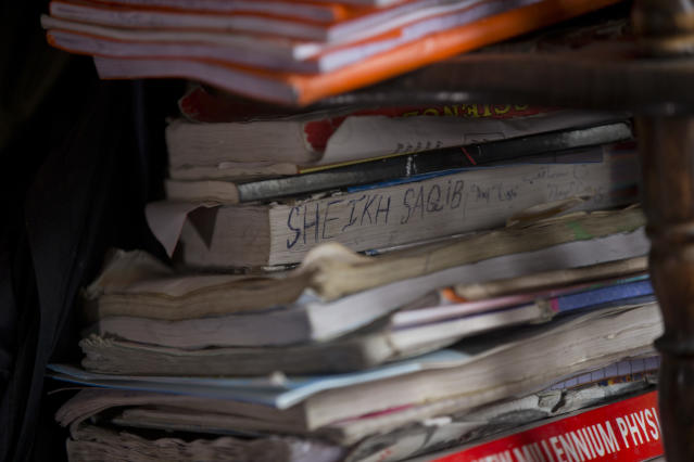 In this Dec. 26, 2018, photo, books belonging to Kashmiri boy Saqib Bilal Sheikh are stacked inside his room in Hajin village, north of Srinagar, Indian controlled Kashmir. Saqib, who was then 16-years-old, and another teenager walked away from a local soccer pitch in the Kashmiri town of Hajin on a hot day in August, only to return home months later in body bags. The boys journeyed together from playfield to armed rebellion, joining a nearly three-decade insurgency that is drawing greater numbers of teenage boys and young men as New Delhi cracks down on anti-India protests. (AP Photo/ Dar Yasin)