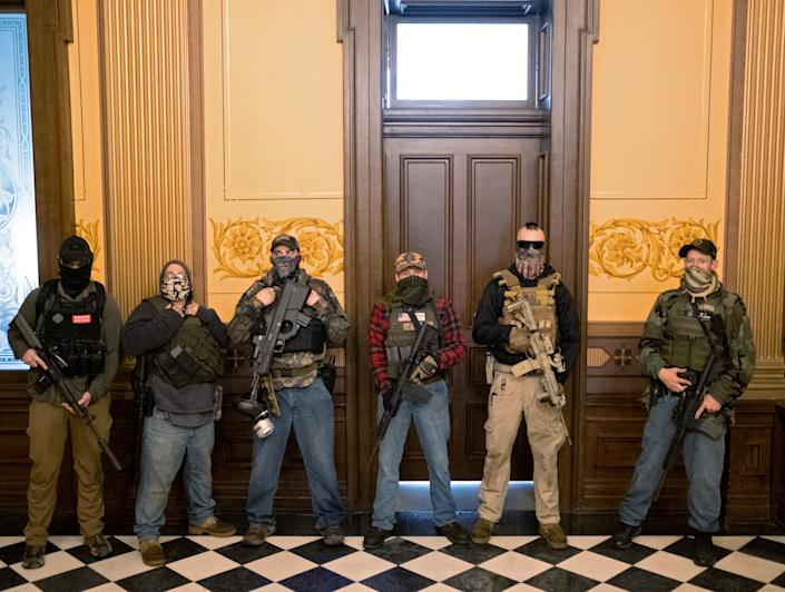 A militia group with no political affiliation from Michigan stands in front of the Governor's office door
