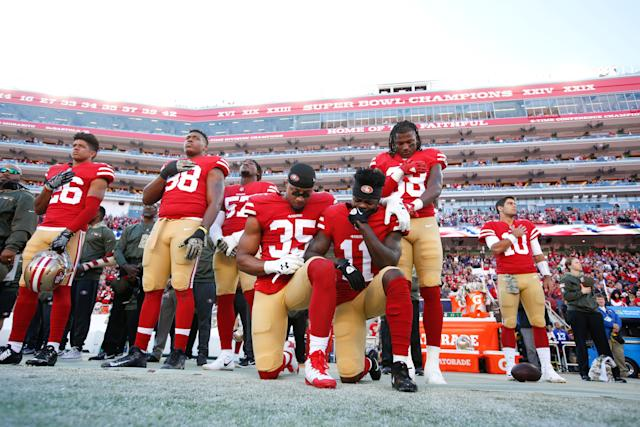 Reid, left, and teammate Marquise Goodwin, right,kneel during the anthem on Nov. 12, 2017, in Santa Clara, California.