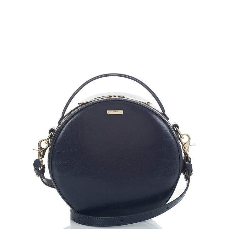 <p>Swap out your black purse for this navy blue <span>Brahmin Lane Topsail Bag</span> ($275).</p>