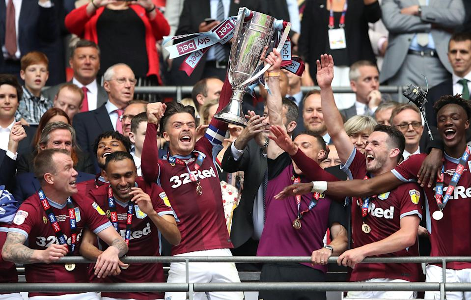 Aston Villa's Jack Grealish (centre) lifts the Sky Bet Championship Play-off Final Trophy with team-mates after the final whistle Aston Villa v Derby County - Sky Bet Championship Play-off - Final - Wembley Stadium 27-05-2019 . (Photo by  Tim Goode/EMPICS/PA Images via Getty Images)