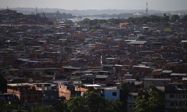 RIO DE JANEIRO, BRAZIL - MARCH 18: Houses stand in the unpacified Complexo da Mare slum complex, one of the largest 'favela' complexes in Rio, on March 18, 2014 in Rio de Janeiro, Brazil. The group of 16 communities house around 130,000 residents while plagued by violence and poverty and dominated by drug gangs. Mare is located close to Rio's international airport and has been mentioned as a likely pacification target for the police. Rio's Police Pacification Unit (UPP) now controls 38 of the city favelas amid the city's efforts to improve security ahead of the 2014 FIFA World Cup and 2016 Olympic Games. (Photo by Mario Tama/Getty Images)