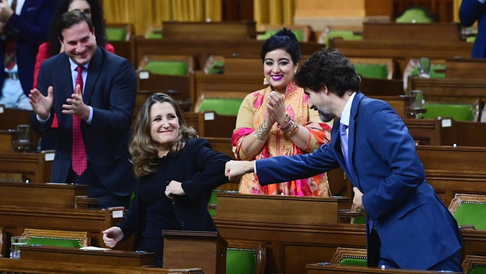 Finance Minister Chrystia Freeland gets a fist bump from Prime Minister Justin Trudeau after delivering the 2020 fiscal update in the House of Commons on Nov. 30, 2020. (Photo: Sean Kilpatrick/CP)