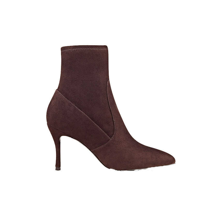 """<a rel=""""nofollow"""" href=""""http://www.anrdoezrs.net/links/3550561/type/dlg/http://www.ninewest.com/Cadence-Pointy-Toe-Booties/3040612,default,pd.html?variantColor=JJ0BVE7&cgid=8346259"""">Cadence Pointy Toe Booties, Nine West, $50<p>A sock-like design and slender, modest heel make these perfect for daytime and evening outings alike.</p> </a>"""